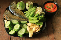 Thai food. Fried mackerel with shrimp paste sauce and various vegetables Royalty Free Stock Image