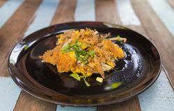Thai food, Fried mussel with egg and bean sprouts in plate on wooden table. In the restaurant stock photography