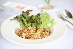 Thai food fried noodle with egg and pork Stock Photos