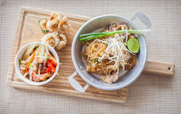 Thai food, fried noodles Thai style with papaya salad. And pork crackling, name in Thai is Phat Thai and Somtum Royalty Free Stock Images