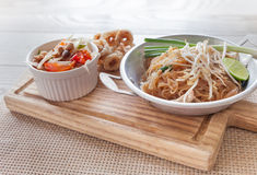 Thai food, fried noodles Thai style with papaya salad. And pork crackling, name in Thai is Phat Thai and Somtum Royalty Free Stock Photos