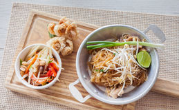 Thai food, fried noodles Thai style with papaya salad. And pork crackling, name in Thai is Phat Thai and Somtum Stock Photo