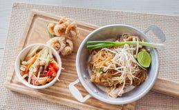 Thai food, fried noodles Thai style with papaya salad Stock Photo