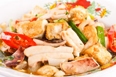 Thai Food. Thai fried food ;squid tofu soybean and vegetables herbs fried with oil Stock Photos