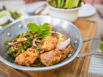 Thai food fusion style, spicy minced salmon salad Larb Salmon,Close up Thai local traditional Isaan Northest. stock photo
