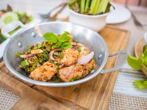 Thai food fusion style, spicy minced salmon salad Larb Salmon,Close up Thai local traditional Isaan Northest. stock images