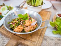 Thai food fusion style, spicy minced salmon salad Larb Salmon,Close up Thai local traditional Isaan Northest. stock photography