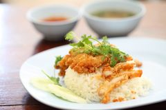 Thai food gourmet fried chicken with rice , khao mun kai tod. In wooden background stock photos