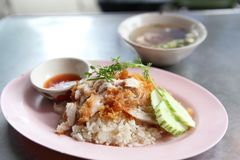 Thai food gourmet fried chicken with rice , khao mun kai tod. In woodeb background royalty free stock photography