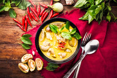 Thai food green curry chicken. On wooden background. top view stock image