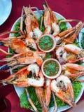 Thai food grilled fresh water prawns and spicy dip [ Macrobrahim roesenbergii]. Cuisine meal river prawn shrimp burned flaming delicious chilli corainder savor Royalty Free Stock Photo