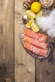 Thai food, ingredients. Rice noodles and salmon, lemon and spices. Dietary food. Healthy food. Wooden background. Place for text. royalty free stock photos