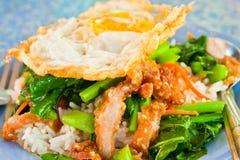 Thai food, kana moo krob.(fried kale mixed crispy pork and egg) Stock Image