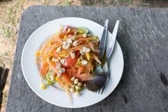 Thai food/ locate food - papaya salad in thailand call som tum o. N wood table at street food, thailand Royalty Free Stock Photography