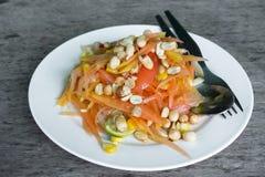 Thai food/ locate food - papaya salad in thailand call som tum o. N wood table at street food, thailand Stock Images