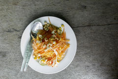 Thai food/ locate food - papaya salad in thailand call som tum o. N wood table at street food, thailand Royalty Free Stock Photo