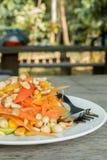 Thai food/ locate food - papaya salad in thailand call som tum o. N wood table at street food, thailand Royalty Free Stock Image