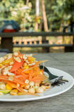 Thai food/ locate food - papaya salad in thailand call som tum o. N wood table at street food, thailand Stock Image