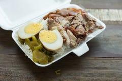Thai food, lunch box stewed pork leg on rice Stock Image