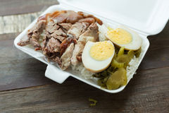 Thai food, lunch box stewed pork leg on rice Royalty Free Stock Images