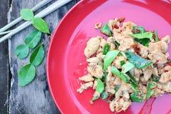 Thai food menu, fried chicken, chili, herbs, lemongrass, kaffir lime leaves in a vintage wooden background plate. Thai food menu fried chicken chili herbs stock image