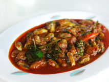 Thai food, mussels in hot, red curry Royalty Free Stock Photos