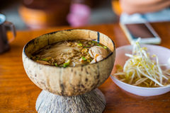 Thai food noodle in coconut shell Stock Photo