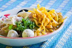 Thai food.noodle soup with fish ball and pork on blue mat Stock Photography