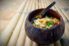 Noodles in a bowl made from coconut shells. royalty free stock photos