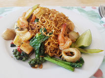 Thai food. Pad kee mao mama. Spicy stir fried noodle.lunch at home Royalty Free Stock Images