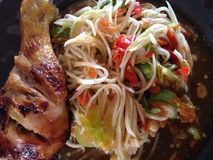 Thai food. Papaya salad and grill chicken Stock Photo