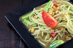 Thai food the papaya salad or somtum in dish on. Selective focus Thai food the papaya salad or somtum in dish on wood background stock image