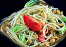 Thai food the papaya salad or somtum in dish on wood background. The Thai food the papaya salad or somtum in dish on wood background royalty free stock photo
