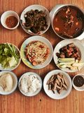Thai food. Papaya salad ,spicy fish soup ,thai sausage ,grilled pork ,stick rice Stock Photography