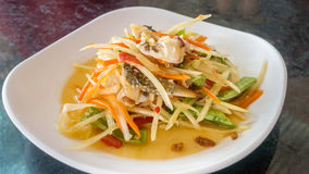 Thai food papaya salad. Thai food spicy papaya salad with pickled brown crab stock images