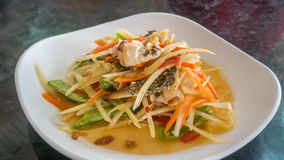 Thai food papaya salad. Thai food spicy papaya salad with pickled brown crab royalty free stock photos