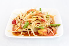 Thai food papaya salad on white dish Stock Photos