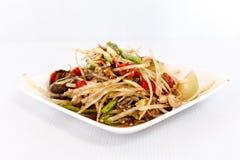 Thai food papaya salad on white dish Royalty Free Stock Image