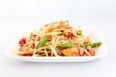 Thai food papaya salad on white dish Stock Image