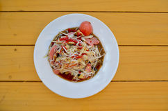Thai Food. Papaya Salad on a white plate placed on a wooden table Stock Photography