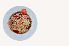 Thai Food. Papaya Salad on a white plate placed on a wooden table Stock Photos