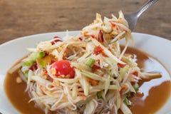 Thai food papaya salad on wooden table. Thai food papaya salad  wooden table Stock Photos