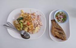 Thai food Pla Nil Tod and brown rice. Thai healthy food  Pla Nil Tod and brown rice Royalty Free Stock Photo