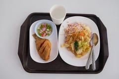 Thai food  Pla Nil Tod and brown rice. Thai healthy food  Pla Nil Tod and brown rice Royalty Free Stock Images