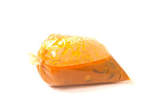 Thai food in plastic bags on white background. Stock Photos