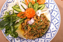 Thai food pork spicy salad with carving vegetable royalty free stock photos