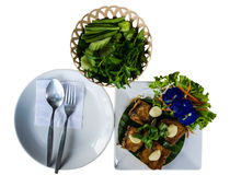 Thai food, prepare for eat spoon fork and dish with fried fish and vegetables. Prepare for eat spoon fork and dish with fried fish and vegetables Stock Photos