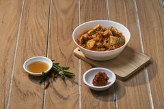 Thai Food Red Curry Pork. Red Curry savory Pork with bamboo slice on wooden barckground, Natural light, Thai food the original stock photo