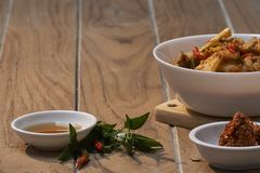 Thai Food Red Curry Pork. Red Curry savory Pork with bamboo slice on wooden barckground,Thai food the original royalty free stock images