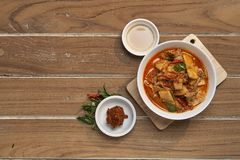 Thai Food Red Curry Pork. Red Curry savory Pork with bamboo slice on wooden barckground,Thai food the original stock photos